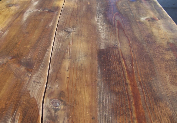 This photo shows the apple-cider stain on the wood. Always work quickly and keep a wet edge. Don't stop on a surface and if you have a helper, have them help, which I did by enlisting my daughter and wife. Also, put a tarp down under the furniture because the stain does stain concrete. I learned the hard way.