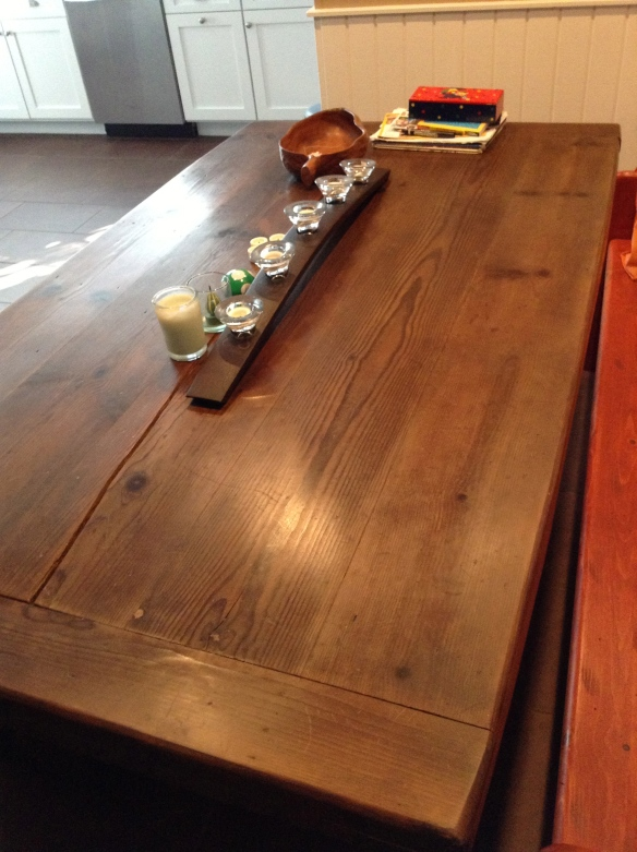 This is the finished table weeks later after my daughter beat it up, but I think it turned out very nice and as it cost only $100, some labor, vinegar, steel wool and wax, it would be okay to tap dance on it. Let it age, I say.