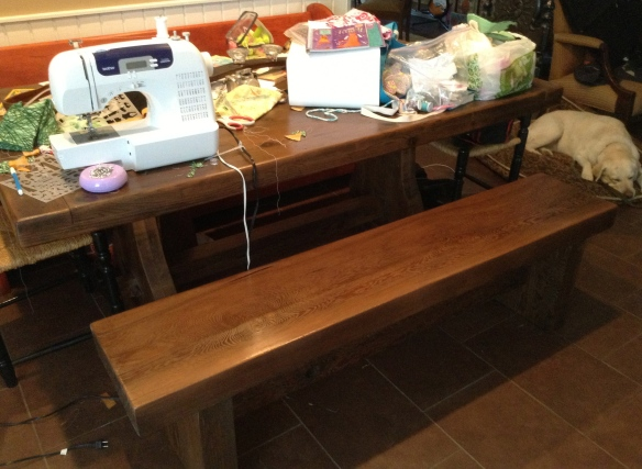 Here is the bench next to the table I refinished. It fit perfectly. And having a bench is cool. My daughter likes it and the table gets a lot more use now.