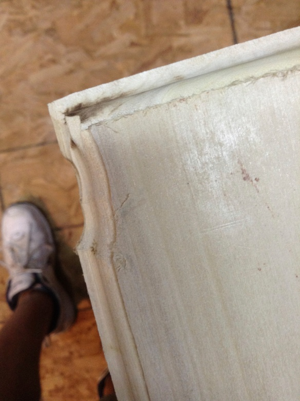 This was the most heartbreaking mistake I made. And I almost gave up. I was tired and impatient and decided to use the router by hand and not on the router table. Oops, big slip. Edge ruined. Goodbye overlay door, hello inset door. That's right. I cut off an equal amount from each side and a little off the top and made it fit inside the closet opening.