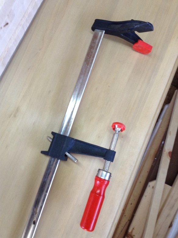 This is a very heavy metal clamp. On December 23, I broke my rule of walking barefoot in the garage. I just needed to readjust the clamps on some Birdseye Maple. Just take me a second. (See next photo)