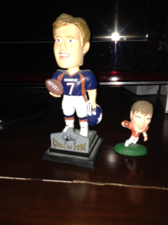Little John Elway and Big John Elway will be there to watch. My friend teases about how big a head the real John Elway has. These two are only slightly larger he says.